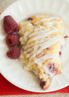 Sweet, flaky, iced Meyer Lemon-Raspberry Scones make the perfect breakfast treat for any occasion, but you can be sure that mom will really enjoy them if you make them for her on #MothersDay! #recipe #baking from @browneyedbaker
