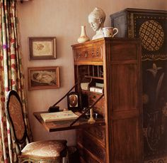 """Vanessa Bell's bedroom at Charleston. """" Vanessa's desk is a nineteenth-century French fall-front secretaire. Quentin [Bell] modelled the rather unconvincing terracotta likeness of his sister Angelica which stands on top. Vanessa designed the cover of..."""
