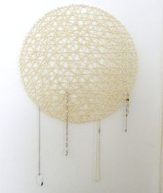 This is a cheap and awesome looking idea for hanging jewelry! <3 It's a Place mat!!