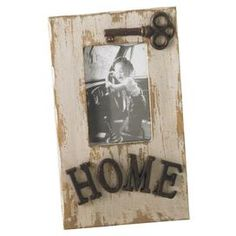 """Weathered white picture frame with antiqued hardware and typographic accents.   Product: Picture frameConstruction Material: WoodColor: White washFeatures: Holds a 4"""" x 6"""" photoDimensions: 11.5 H x 7 W x 1 D"""