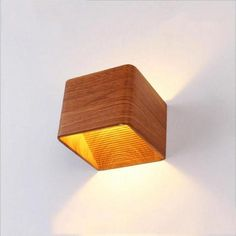 Wooden Modern LED Up Down Cube Wall Lamp – Warmly Get this gorgeous, modern lamp - perfect for additional lighting! Made from aluminum and acrylic. Suitable for voltage: 90 - and Measures Wall Mounted Lamps, Led Wall Lamp, Luxury Lighting, Modern Lighting, Task Lighting, Outdoor Lighting, Led Ceiling Lights, Hanging Lights, Hanging Lamps