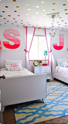 Cute idea for a shared bedroom! Love the letters above the beds & polka dots on the ceiling!