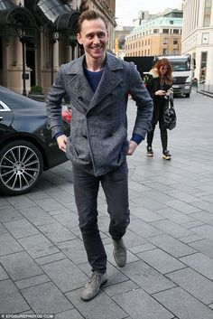 Big smiles: Tom Hiddleston arrived at the BBC studios on Wednesday where he discussed James Bond and Doctor Who