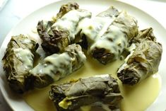 Dolmades me Avgolemono (stuffed grape leaves)  A favorite Greek food that is so good you can't even begin to describe how delicious it is.