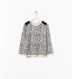 Image 1 of PRINTED SWEATER WITH SHOULDER DETAIL from Zara