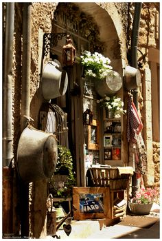 "Ménerbes ~ France. It is ok for your retail exterior to ""wear"" some of your merchandise. Sure looks nice in Provence! PopUp Republic"