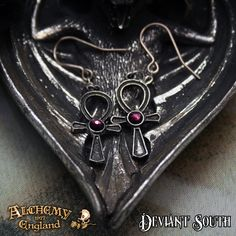 Alchemy Gothic E372 Ankh of Osiris  A pair of small, antiqued pewter Egyptian ankh droppers, suspended on a short length of chain and each set with an amethyst Swarovski crystal; on surgical steel ear-wires.