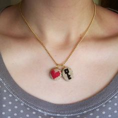 This cross stitch heart and key necklace is very sweet.