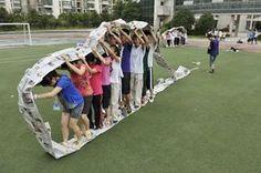 Kids inside the newspaper caterpillar wheel!