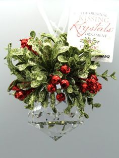 Mini Hanging Mistletoe Krystal Ball Ornament by Ganz Legend of Kissing Under The Mistletoe Is an Old European Tradition It Is Believed That Peace, Strength, Health, Fertility & Love Will Be Granted To All Who Kiss Beneath It Features Sprigs of Glittery-Dusted Mistletoe With Red Berries & a Faceted Acrylic Crystal Ornament Perfect For Christmas Decoration or On Display Throughout The Holidays The Ideal Accent For a Winter Wedding Measures Approxmately 5 Inches Wide & Hangs 6-1/2 Inches