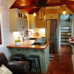Check out this 37′ gooseneck luxury tiny home! The farmhouse, rustic styling and spacious size will make you feel right at home from the minute you enter. The living room is spacious with 11 foot ceilings, clerestory windows, and timber frame beams. The custom kitchen features shaker style cabinets with butcher block countertops, stainless steel…
