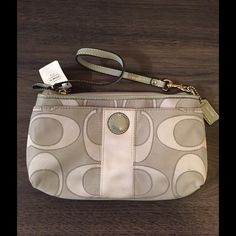 Coach Signature Satin Outline C Wristlet NWT.  Zip closure.  Front open pocket.  8 card slots and 1 interior pocket.  Hang tag.  Silver hardware.  Jacquard patent.  Measures: 9x1.5x5.25. Coach Bags Clutches & Wristlets