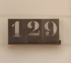 These steel house numbers would look neat inside on a shelf somewhere with our wedding date instead