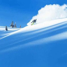 Travis Rice blue sky and a face full of powder. Photo by Scott Serfas #snowboard