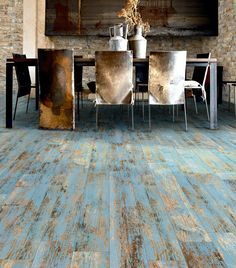 Worn wood look floor from Mettro Source. It's porcelain tile! - voguehome.org