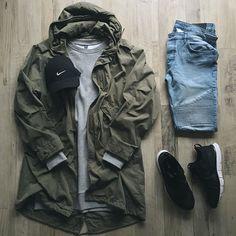 Army green parka, heather grey crewneck, indigo moto, black Nike sneakers, black Nike camp hat #style #streetwear #fit