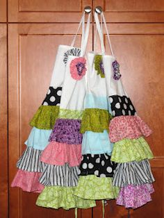 """Ruffle Aprons I have had these ruffled aprons pinned forever and finally decided to make them for my daughter's """"Hello Kitty Baking Birthday Party"""". I think they turned out so cute. Pin from Kayboo Creations by AKT."""