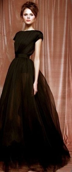 This silhouette is something that would be appropriate, if worn with a little jacket, for a woman in the late 1800's, early 1900's. The dark color would be worn at night to dinner or a show, although the fabric would be entirely different, the high neckline, fullness of the skirt, and emphasis on the waist bring it to that era. 1/25/15