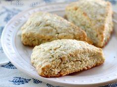Tender, flaky lemon poppy seed scones topped with a sweet lemon glaze.