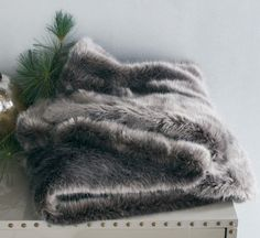 Pewter faux fur throw, on sale for $95 (from $119) at West Elm.