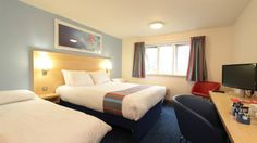 """A woman has received an apology and full refund from Travelodge after discovering the words """"I'm going to rape you"""" displayed on her hotel room's television screen."""