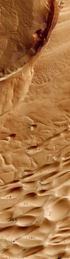 Martian plain from 200 miles up. Michael Benson/NASA/JPL/University of Arizona/Kinetikon Pictures