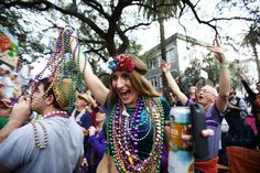 Brielle Dickson cheers after catching beads from a float in the Krewe of Thoth