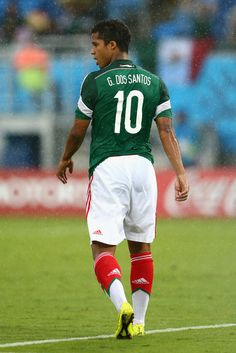 Giovani dos Santos of Mexico walks on the field in the rain during the 2014 FIFA World Cup Brazil Group A match between Mexico and Cameroon at Estadio das Dunas on June 13, 2014 in Natal, Brazil.