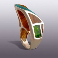 Moshe Botser | Ring 'Tribute to Frank Gary'. Sterling silver and coloured transparent resin.