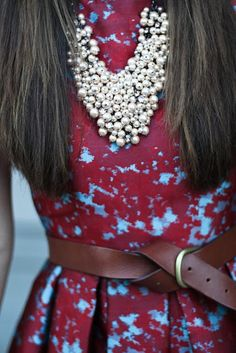 Gorgeous pearl statement necklace on floral print and leather belt