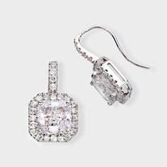 5.0 Ct. Princess Cut  14K Drop Earring. High quality cubic zirconia earrings feature a 2.5 princess cut surrounded by prong set round stones. An approximate 5.96 total carat weight measure 7/8th of an inch long. These beautiful cubic zirconia earrings are set in 14K white gold, also available in 14K yellow gold via special order. Cubic zirconia weights refer to equivalent diamond carat size.