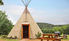 Go glamour camping—glamping—in modern tipis equiped with flat-screen TVs and private bathrooms in Texas #GrouponGetaways
