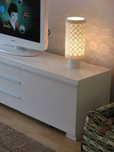 Pretty lamp with an equally pretty white Besta Burs TV unit & white TV!