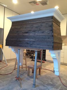 Pure gorgeousness!!  I'd want some sort of mantle on it to accessorize :) Wood range hood, Reclaimed wood.