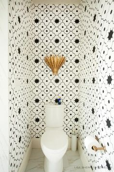 Our toilet room! Taj Trellis Noir Wallpaper frames this small powder room allowing for black and white Moroccan walls to creates a larger decorative illusion. Gold Wallpaper Bathroom, Powder Room Wallpaper, Of Wallpaper, Trellis Wallpaper, Wallpaper Toilet, Closet Wallpaper, Moroccan Wallpaper, Moroccan Wall Stencils, Wallpaper Designs