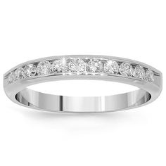 This elegant womens diamond wedding band is handcrafted in lustrous Platinum. Eleven small round cut brilliant diamonds are placed half way around the band and total to 0.35 carats. The frame measures to 1/8 Inches in width and weighs approximately 4.6 grams. This simple womens diamond wedding band is an ideal gift for that special occasion. $1,601.00