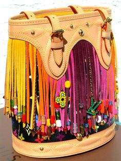 This is probably the only designer bag I would want to rock! So Hippie. <3 it. LOUIS VUITTON Multicolor Fringe Bucket bag