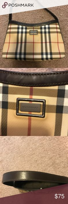 """Smaller, older Burberry purse Older style Burberry purse. It has a few marks (see photos) and corners are showing signs of wear but it is still in good condition and will last for a long time! It is 9"""" long, 6 1/2"""" high plus another 6 1/2"""" for the strap and 2"""" deep. I will trade for a Coach or another Burberry. Only reasonable offers please .../ Burberry Bags Mini Bags"""