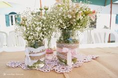 for the tables lots of diferengt maison jars decorated with row materials for this shabby chic girl' party