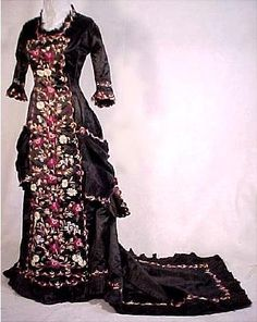 1877 one-piece princess gown in black silk with incredible floral embroidery