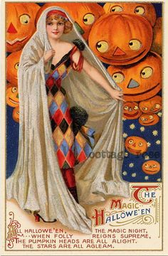 Love everything about this, from the dress to the pumpkins' faces.