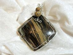 Large Petrified Wood Pendant Unisex Wire Wrapped by jewelrybypatterson