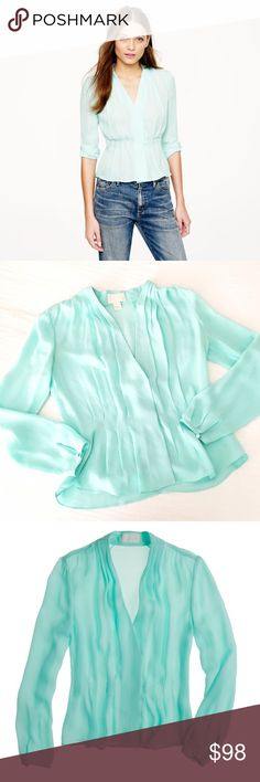"""j.crew collection draped georgette top Hand draped silk georgette gives this beautifully crafted top a romantic (and endlessly flattering) silhouette. Seamlessly finished with hidden snaps, it adds an effortlessly elegant touch to any ensemble. Tailored fit, silk, 22"""" long, long sleeves, dry clean only. Such a gorgeous piece!! And unbelievably flattering. Only flaws to note are some mild pulling at the seams, not noticeable when worn. Runs large IMO, could fit up to a 2-4 size top, as long…"""