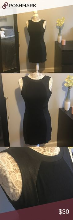 Express Black Mini Dress Black mini dress from express. Mixed material with cute side panels. Super slimming! Rear exposed zipper closure. Express Dresses Mini