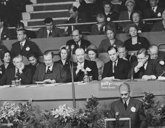 Conservative Party politicians Lord Hailsham (right), Sir David Eccles (left), Duncan Sandys (second from left) and Peter Thorneycroft (centre), sitting on stage during the party conference in Brighton, October 10th 1957.