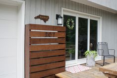 Hide those ugly utility boxes on your house with this gorgeous DIY wood screen.