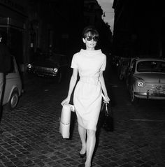 Audrey Hepburn...night or day....stunning..here in a sheath with a mini-boat neck & pencil skirting....