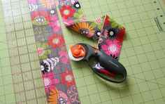 """Cut one piece of fabric using your rotary cutter so it measures 3"""" wide x 40"""" long."""