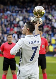 MADRID, SPAIN - JANUARY Cristiano Ronaldo of Real Madrid holds the Ballon d'Or France Football trophy before the La Liga match between Real Madrid and Granada CF on January 2017 in Madrid, Spain. (Photo by Angel Martinez/Real Madrid via Getty Images) Cristano Ronaldo, Cristiano Ronaldo Juventus, Granada Cf, Football Trophies, Ballon D'or, Manchester United Football, January 7, Real Madrid, Spain
