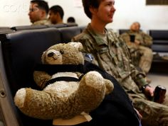 Major Amy Gray, occupational therapist of Task Force Bronco sits next to her 43-year-old teddy bear while waiting for a flight to return home to the U.S. at the pax terminal of FOB Fenty after finishing her one-year assignment in Nangarhar province, eastern Afghanistan March 12, 2012. REUTERS/Erik De Castro (AFGHANISTAN - Tags: MILITARY CIVIL UNREST)